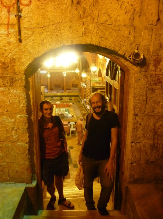 With friends outside the bathhouse in the Aleppo Souk, now occupied by rebel fighters.
